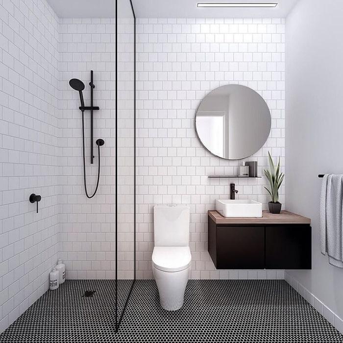Đặt một chậu cây nhỏ tại bồn rửa mặt sẽ không ảnh hưởng đến phong cách thiết kế tối giản